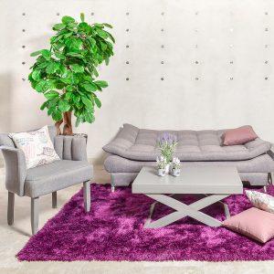 Sofá cama gris y complementos de sala